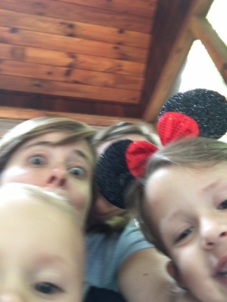 My failed (but funny) attempt to snag a photo with sister, niece and nephew. Mouse ears blocked my face.