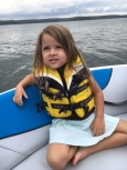 She reminds me of me in the front of a boat <3
